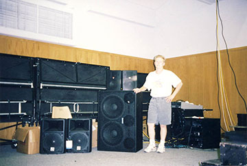 Shawn at age 17 installing an AV system in a professional theater in Santa Cruz, CA. featuring Sound Craft, Bag-End Speakers, and a Crown Amp.